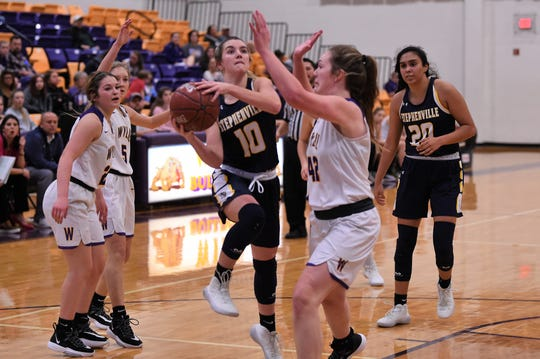 Stephenville's Kassidy Nowak (10) goes up for a shot against Wylie's Bailey Roberts (42) at Bulldog Gym on Tuesday, Dec. 31, 2019. Nowak had a team-high 13 points as the Honeybees comeback came up short, falling 50-46.