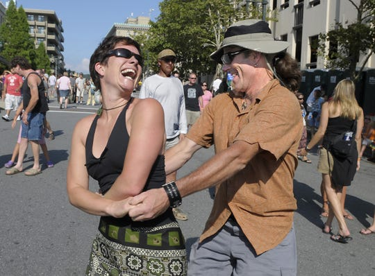 Lisa Sackville and Michael Graney dance to the music of The Hip Abduction at the battery park stage during Bele Chere on July 24, 2009.