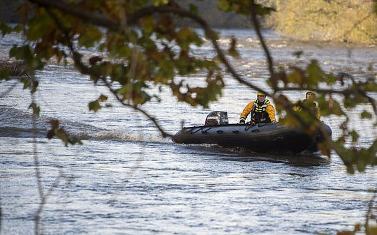 Asheville Fire and Rescue search the French Broad River on Oct. 29, 2015, for clues as to the whereabouts of Alexandra Brooke King, 22, and Tatianna Diz, 20. Their bodies were found days later.