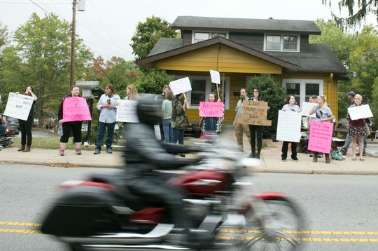 Nearly 50 peaceful protesters line the sidewalk in front of Waking Life Espresso shop on Haywood Road in West Asheville in September 2015 to protest the shop?s owners and their social media posts.