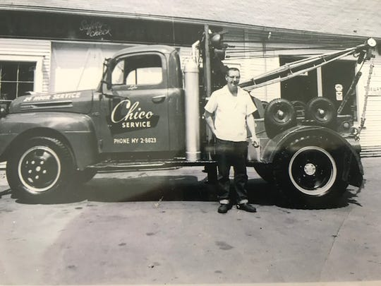 Stacey Tucker's grandfather Don Tucker stands with one of the original fleet at Chico Towing.