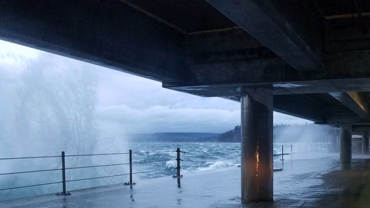 Waves crash against the Hood Canal bridge during high winds on Tuesday.