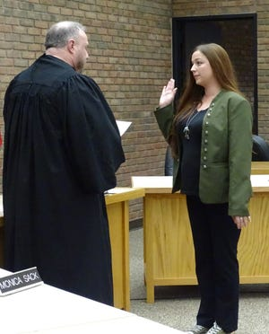 Candace Yocum, right, is sworn into office as the 2nd Ward representative to Bucyrus City Council in late December by Crawford County Common Pleas Court Judge Sean Leuthold. Yocum resigned Thursday.