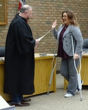 Bucyrus City Council member Lisa Alsept, right, is sworn into office Monday by Crawford County Common Pleas Court Judge Sean Leuthold in city council chambers.