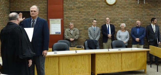 Crawford County Common Pleas Court Judge Sean Leuthold, left, administers the oath of office to Bucyrus City Council member Bruce Truka   in January 2020. Truka announced Wednesday he will not seek another term.