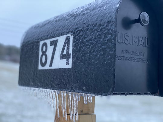 """Ripples of ice and frozen icicle stalactites on a mailbox are reminders of the conditions mail carriers face. Do they """"approve"""" of the weather? Taken Dec. 30, 2019."""