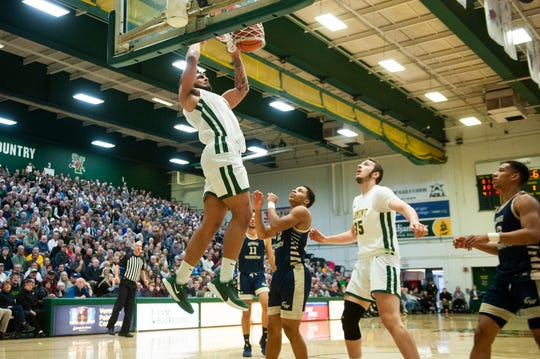 Senior forward Anthony Lamb rises for two-handed dunk in the first half of Vermont's 76-51 win over George Washington on Dec. 31, 2019.  Lamb finished with a game-high 23 points.