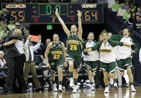 Vermont's Tonya Young (25) leads the team off the bench following their victory over Wisconsin in an NCAA first-round college basketball game in South Bend, Ind., Sunday, March 21, 2010. Vermont defeated Wisconsin 64-55.