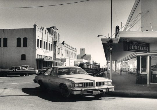 A car turns from Starr Street onto North Mesquite Street in downtown Corpus Christi next to Taylor Bros. Jewelers in November 1985.