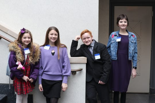 Paul St. Pierre is joined by Sailor Oakes of Point Pleasant (from left), Reagan Schenkel of Flemington and Jordan Check of Sayreville at the New Jersey State House in Trenton on Dec. 16. The girls' mothers reached out to Paul's mother, Colleen Quinn of Maple Shade, to support her and Paul's campaign for seizure-safety legislation.