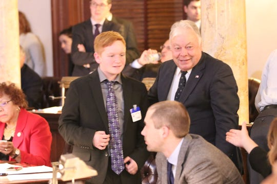 Paul St. Pierre, 13, of Maple Shade walks with state Sen. Jim Beach after Beach invited the teen to push the 'yea' button in voting for Paul's Law. The legislation, which the teen and his mother, Colleen Quinn, lobbied for, would require school personnel to have seizure-safety training.