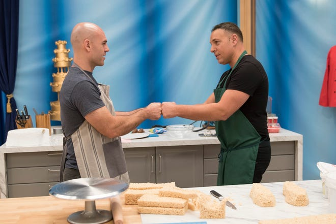 Al DiBartolo fist bumps his baking partner XXX on an upcoming episode of 'Food Network Challenge.' Hall is a Food Network alumnus who competed on 'Halloween Wars' with DiBartolo.