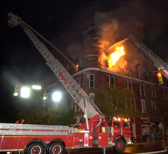Firefighters battle the blaze at the Carlisle Building in 2003.