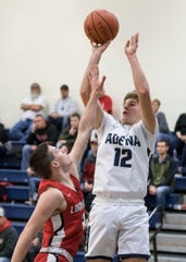 Adena's Preston Sykes shoots over Logan Elm to score at Adena High School on Dec. 30, 2019. Logan Elm defeated Adena 54-41.