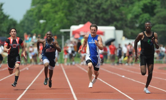 In 2010 Southeastern's Steven Hall, second left, nears the finish line in the 100 meter dash during the Division II state track tournament in Columbus.