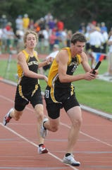 Paint Valley's Daniel Gardner hands the baton to Logan Markko in the Div. III 4x800 relay on Friday at Jesse Owens Stadium in Columbus during the state track finals in 2011.