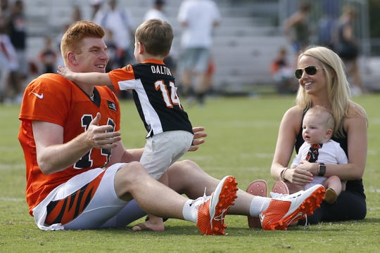 Andy Dalton plays with his son, Noah, as Jordan Dalton holds Nash after practice, Tuesday, Aug. 8, 2017.