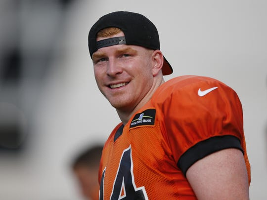 Andy Dalton smiles at a fan during training camp, Friday, Aug. 5, 2016.