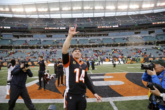 Andy Dalton smiles as he heads for the locker room after the fourth quarter of the NFL Week 17 game between the Cincinnati Bengals and the Cleveland Browns on Sunday, Dec. 29, 2019.