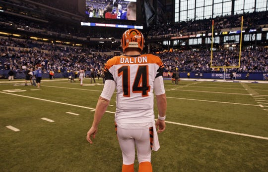 Bengals quarterback Andy Dalton walks to the locker room after the Colts beat the Bengals at Lucas Oil Stadium in an AFC division playoff game on Jan. 4, 2015.