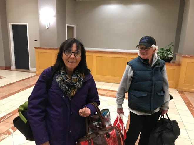 Deborah Daley, left, and her husband, Kevin. The Rhode Island couple was among the last 20 guest to spend the night at The Millennium Hotel Cincinnati.