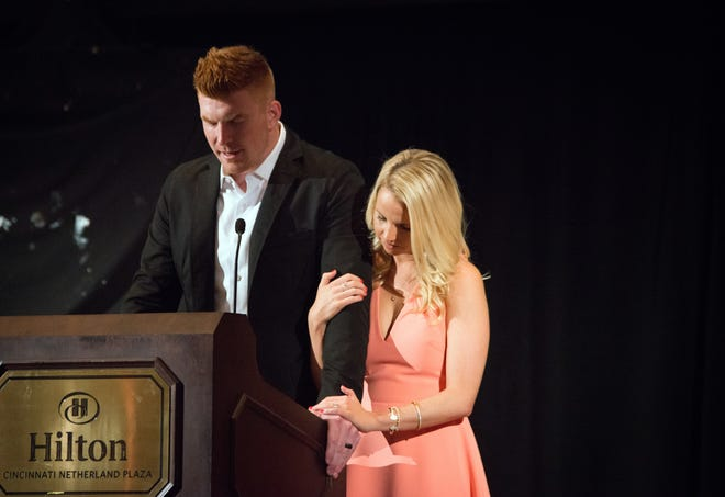 Andy Dalton, Bengals' quarterback, and his wife Jordan held a celebrity waiter night for the Andy and Jordan Dalton Foundation at the Hilton Hotel Monday June 6, 2016. Dalton says a prayer before dinner inside the Hall of Mirrors.
