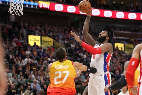 Andre Drummond shoots over Jazz center Rudy Gobert during the first quarter Monday.