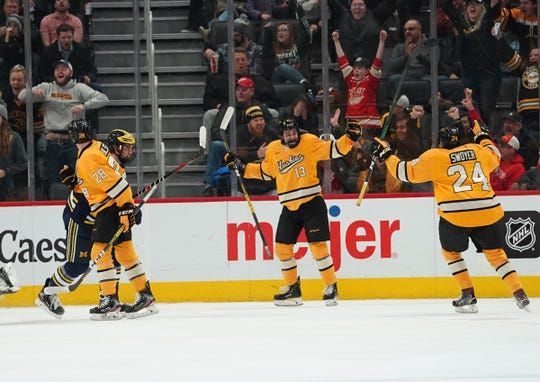 Michigan Tech forward Logan Pietila scores a goal during MTU's 4-2 win over U-M in the the 55th annual Great Lakes Invitational championship at Little Caesars Arena in Detroit on Tuesday, Dec. 31, 2019.
