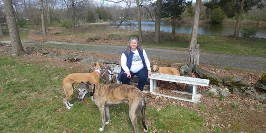 Anne Thimm, a retired analyst from Alexandria, Virginia is glad the Mustang Mach-E will hold her dogs: Truman, a retired racing greyhound; Tina, a Spanish Galgo; and whippets, Bambi and Remi. The photo was taken in Spring 2017 in Lake Anna, Virginia.