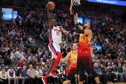 Utah Jazz center Rudy Gobert (27) tries to block the shot of Detroit Pistons guard Tony Snell (17) during the first quarter of an NBA basketball game, Monday, Dec. 30, 2019, in Salt Lake City. (AP Photo/Chris Nicoll)