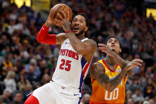 Pistons guard Derrick Rose drives to the hoop against Jazz guard Jordan Clarkson during the second quarter on Monday, Dec. 30, 2019, in Salt Lake City.