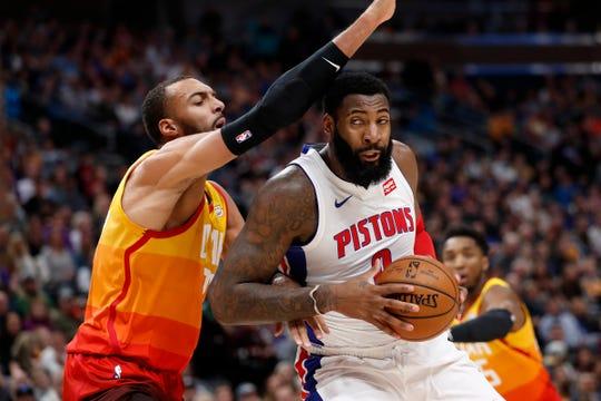 Pistons center Andre Drummond drives to the hoop against Utah Jazz center Rudy Gobert on Dec. 30, 2019, in Salt Lake City.