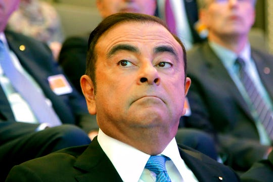 In this Oct. 6, 2017, file photo, former Nissan Motor chairman Carlos Ghosn attends a media conference outside Paris, France.
