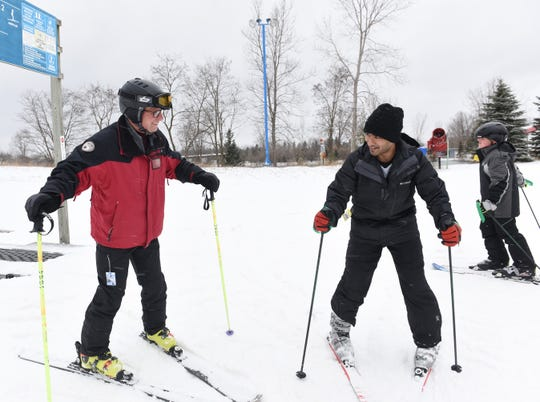 Instructor Bill Wirsing, left, teaches Varun Srini-Vasan, 21, how to ski during his $65  per hour lesson at Mt. Holly Ski and Snowboard Resort.