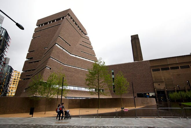 In this Tuesday, June 14, 2016 file photo, an exterior view shows a new building called the Switch House, at left, which has been added on to the Tate Modern gallery in London. London police have charged a man with criminal damage after an attack on a Picasso painting at the Tate Modern gallery.