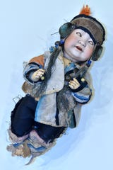 The porcelain doll from Queen Elizabeth II's nursery, owned by Debbie Savalle of Dryden, is in her original clothes. 