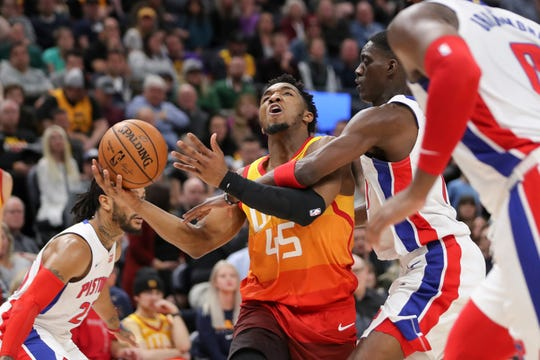 Utah Jazz guard Donovan Mitchell (45) is fouled by Detroit Pistons forward Thon Maker (7) while shooting the ball during the fourth quarter.