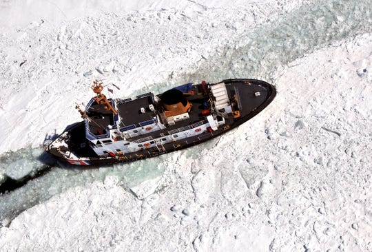 FILE - The U.S. Coast Guard cutter Katmai Bay works in thick ice to open a channel near Neebish Island on St. Mary's River, March 27, 2015.