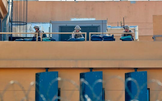 U.S. soldiers prepare defensive position on the roof of the U.S. embassy in Baghdad, Iraq, Tuesday, Dec. 31, 2019.