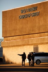 Texas Department of Public Safety troopers secure the parking lot before church and community members gather outside the West Freeway Church of Christ for a candlelight vigil, Monday, Dec. 30, 2019.