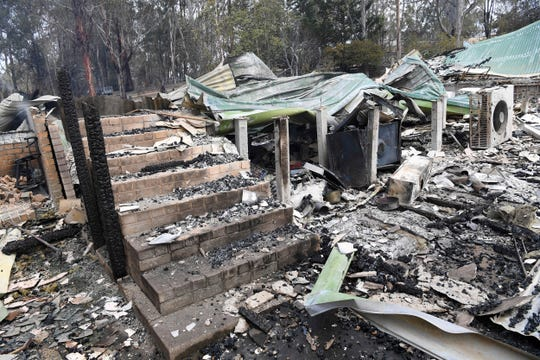 A burnt-out residence is seen in Sarsfield, East Gippsland, Victoria, Tuesday, Dec. 31, 2019.
