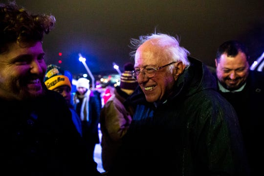 U.S. Sen. Bernie Sanders, I-Vt., greets people in the crowd after lighting a menorah during the Chanukah on Ice celebration at the Brenton Skating Plaza on Sunday, Dec. 29, 2019, in Des Moines, Iowa.