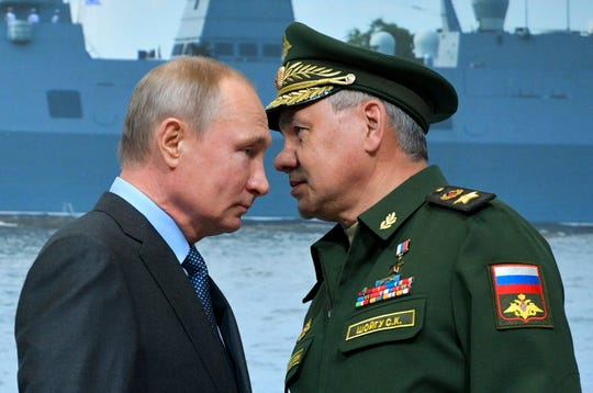 FILE In this file photo taken on Tuesday, April 23, 2019, Russian President Vladimir Putin, left, and Russian Defense Minister Sergei Shoigu during a visit a shipyard in St. Petersburg, Russia.