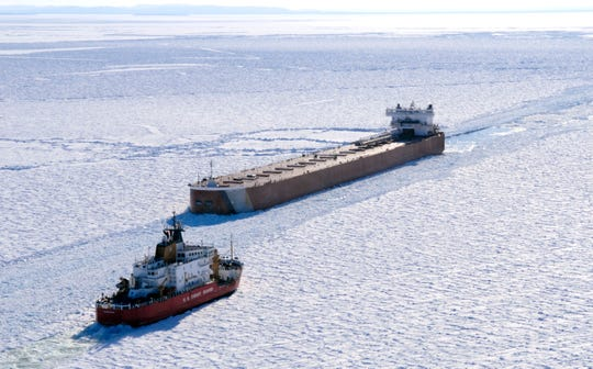 FILE - The U.S. Coast Guard cutter Mackinaw works in thick ice to break out a freighter in Whitefish Bay of Lake Superior on March 27, 2015.