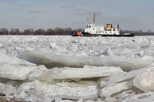 The Coast Guard cutter Bristol Bay breaks a path for an approaching vessel in Marine City in this file photo. When the lakes freeze over, rising water levels create a growing problem to keep the shipping channels clear of ice until April.