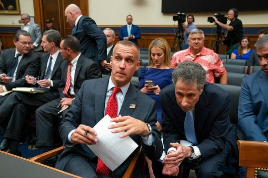 Corey Lewandowski, former campaign manager for President Donald Trump, talks with his attorney Peter Chavkin, right, as he testifies before the House Judiciary Committee, Tuesday, Sept. 17, 2019, on Capitol Hill.