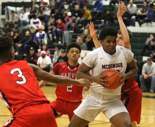 Dani-Dennis Sutton of McDonogh is surrounded by three Painesville Ohio players during McDonogh's 65-33 win in  the National Division boys championship game at the Josh Palmer Fund Elmira Holiday Inn Classic on Dec. 30, 2019 at Elmira High School.