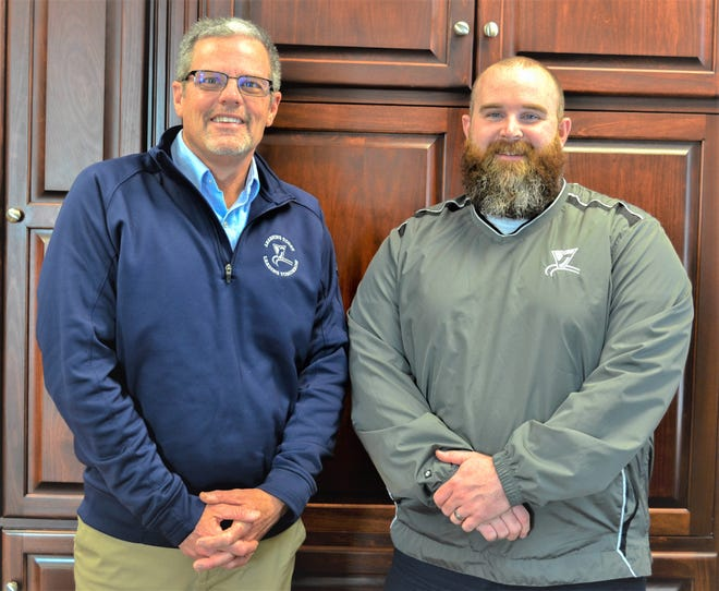 Alex Binger, right, was hired as Vanguard's new treasurer in November. He took over the position from his father, Alan Binger, left, who retired on Dec. 30.