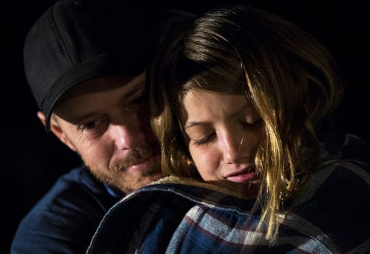 Brooklynn Tamplin, 9, is comforted by her uncle Gene Tamplin Wednesday evening at her home in North Fort Myers. The younger sibling was remembering her sister Alana who was killed while walking home when a vehicle ran into her Monday, January 14, 2019.