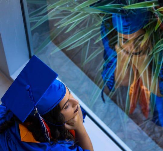 Kaylene Powell, 18, sits in reflection prior to the start of the Cape Coral High School graduation ceremony Saturday afternoon, May 18, 2019, at Suncoast Credit Union Arena. About 360 graduates accepted their diplomas.